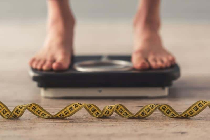 Person on weighing machine